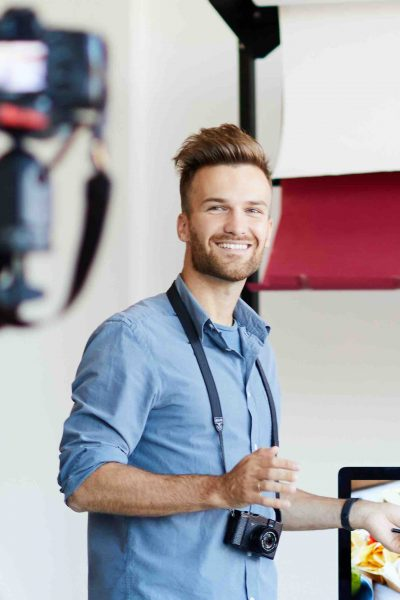 Full length portrait of handsome man leading online seminar on food photography, copy space